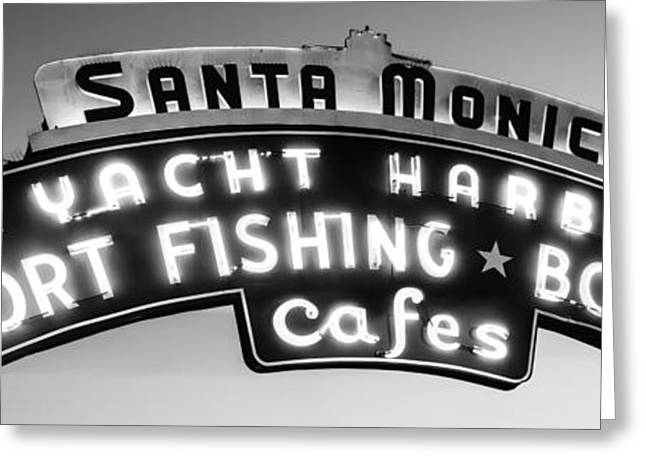 Black And White Photos Greeting Cards - Santa Monica Pier Sign Panoramic Black and White Photo Greeting Card by Paul Velgos