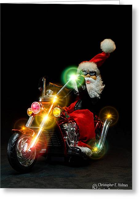 Santa Motoring Greeting Card by Christopher Holmes