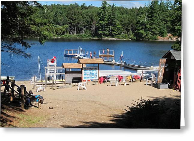 Canoe Photographs Greeting Cards - Santa Waterfront Watch Sabattis Adventure Camp Greeting Card by Sven Migot