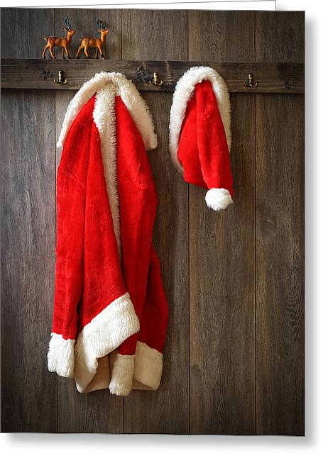 Peg Greeting Cards - Santas Coat Greeting Card by Amanda And Christopher Elwell