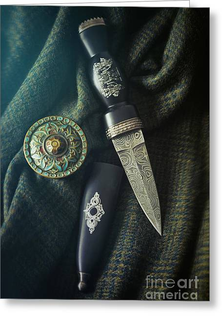 Ancient Jewelry Photographs Greeting Cards - Scottish dirk and celtic pin brooch on plaid Greeting Card by Sandra Cunningham