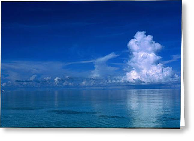 Ocean. Reflection Greeting Cards - Sea & Clouds The Maldives Greeting Card by Panoramic Images