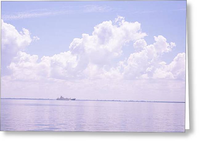 Water Vessels Greeting Cards - Sea With A Container Ship Greeting Card by Panoramic Images