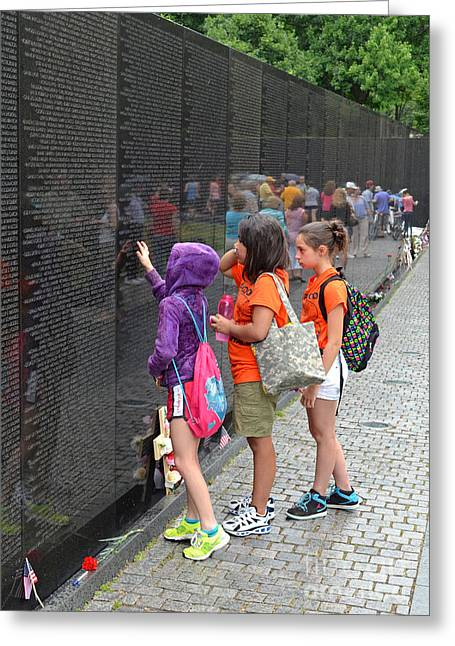 Searching A Loved Ones Name On The Vietnam Veterans Memorial Greeting Card by Jim Fitzpatrick