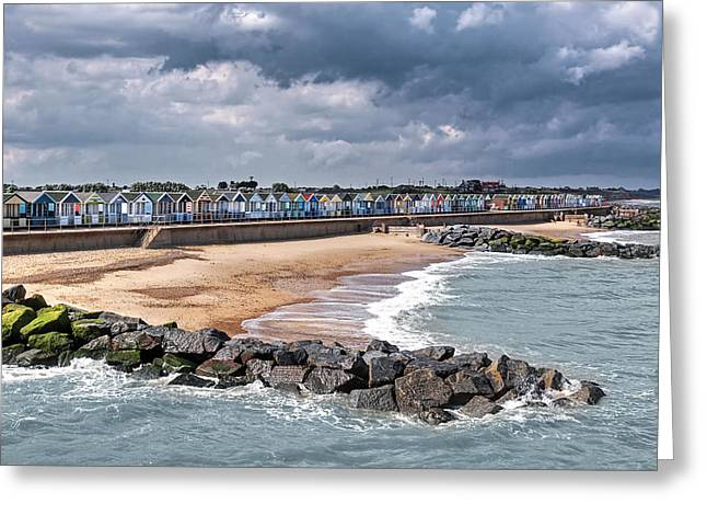 Ocean Front Landscape Greeting Cards - Seaside Storm - Colorful Beach Huts Greeting Card by Gill Billington