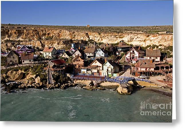 Clapboard House Greeting Cards - Seaside Village Under The Cliffs Greeting Card by Tim Holt