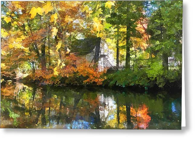 Dappled Sunlight Greeting Cards - Seasons - White House by Lake in Autumn Greeting Card by Susan Savad