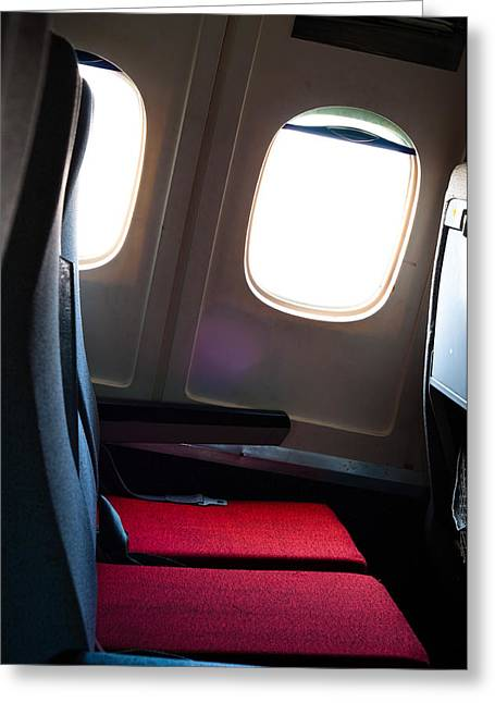 Controlled Pyrography Greeting Cards - Seat of an airplane with windows in the background Greeting Card by Oliver Sved