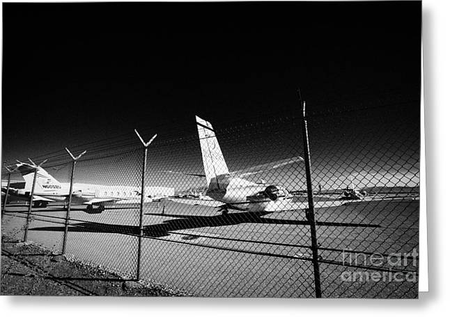 Commuter Plane Greeting Cards - Security Chain Link Fencing With Warning Restricted Area Sign On The Perimeter Of Mccarran Airport Greeting Card by Joe Fox