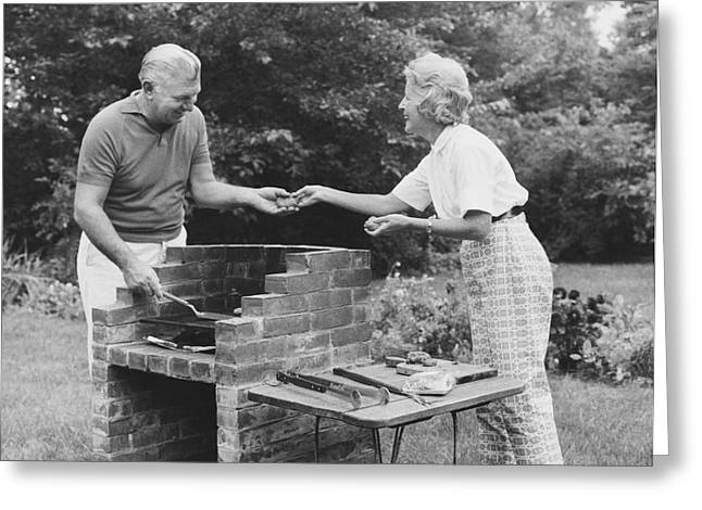 Firepit Greeting Cards - Senior Couple Cooking Greeting Card by Suzanne Szasz