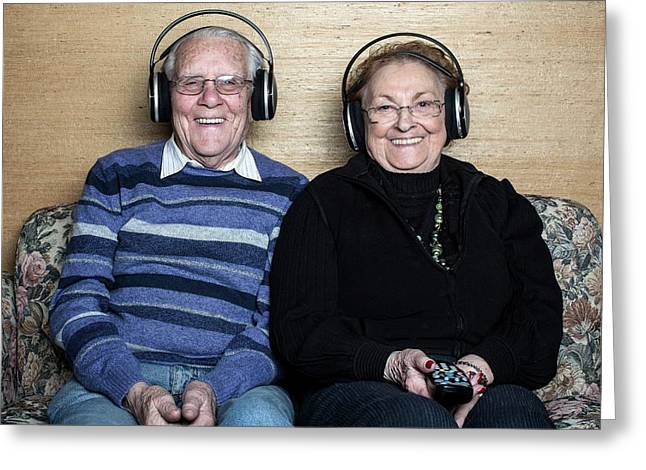 Senior Couple Wearing Headphones Greeting Card by Mauro Fermariello