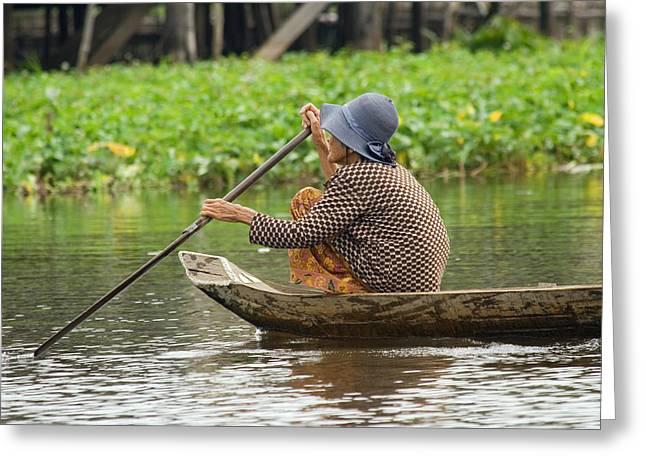 Tonle Greeting Cards - Senior Woman Paddling a Boat Greeting Card by Artur Bogacki