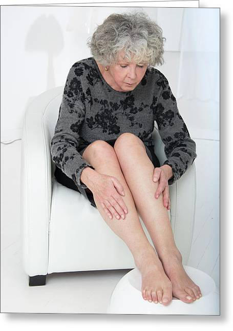 Senior Woman Touching Her Legs Greeting Card by Lea Paterson