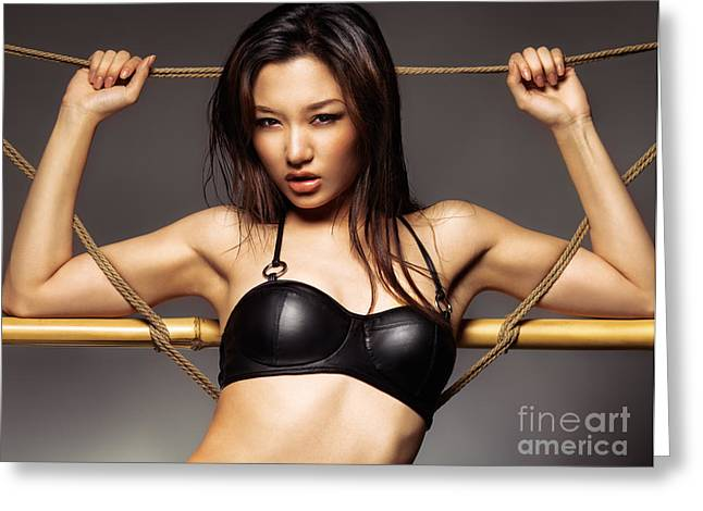 Worn Leather Photographs Greeting Cards - Sexy asian woman in black leather bra Greeting Card by Oleksiy Maksymenko