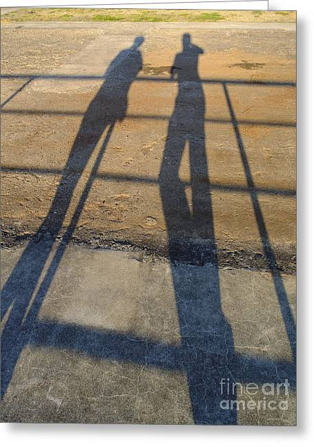 Elongated Shadows Greeting Cards - Shadows of Two People Greeting Card by Jannis Werner