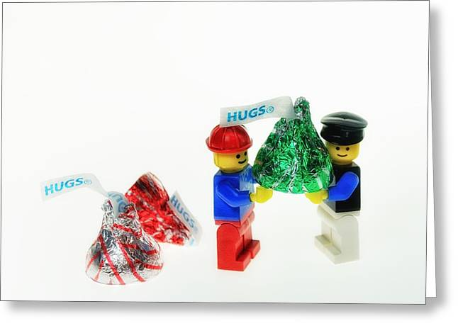 Lego Greeting Cards - Sharing A Hug Greeting Card by Mark Fuller