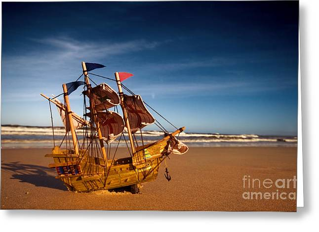 Toy Boat Greeting Cards - Ship model on summer sunny beach Greeting Card by Michal Bednarek