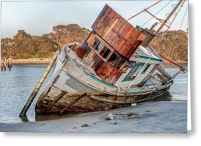 Water Vessels Greeting Cards - Shipwreck Awash on Beach Greeting Card by Ken Wolter