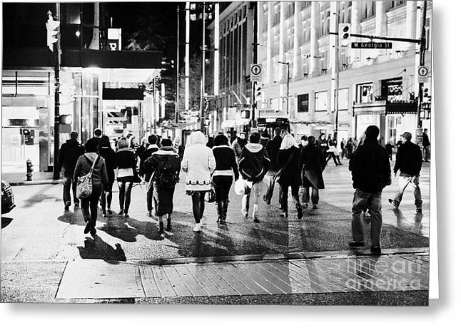 Crosswalk Greeting Cards - shoppers crossing corner of granville and west georgia streets at night Vancouver BC Canada Greeting Card by Joe Fox
