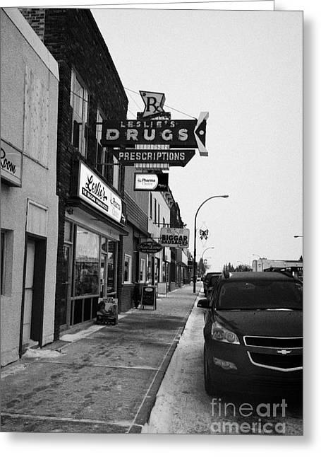 Main Street Greeting Cards - shops and stores on the main street Biggar Saskatchewan Canada in winte Greeting Card by Joe Fox