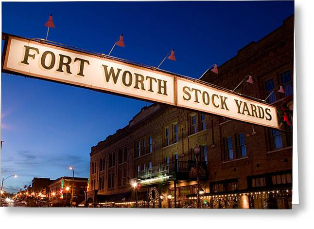 Main Street Greeting Cards - Signboard Over A Road At Dusk, Fort Greeting Card by Panoramic Images