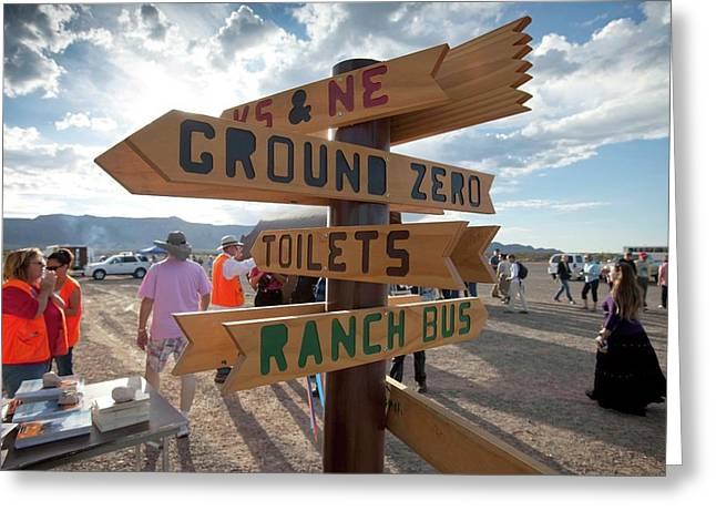 Signpost And Tourists Greeting Card by Peter Menzel