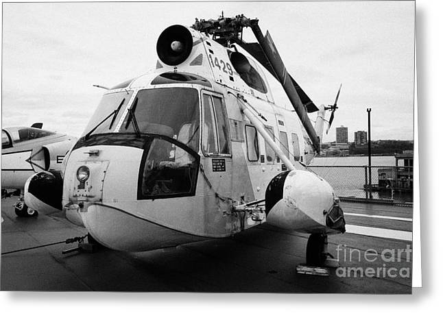 Manhatan Greeting Cards - Sikorsky HH 52 hh52 Sea Guardian helicopter on display on the flight deck Greeting Card by Joe Fox