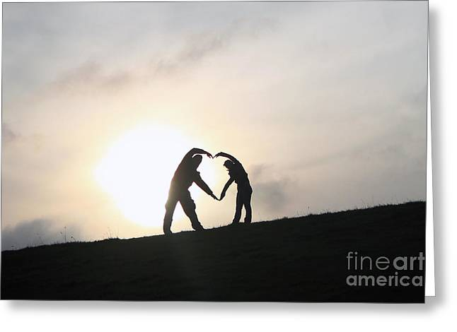 Silhouettes Greeting Cards - Silhouette Couple forming a heart Greeting Card by Lars Ruecker