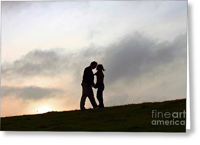 Silhouettes Greeting Cards - Silhouette Couple holding each other Greeting Card by Lars Ruecker