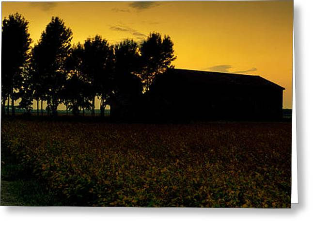 Field. Cloud Greeting Cards - Silhouette Of A Farmhouse At Sunset Greeting Card by Panoramic Images