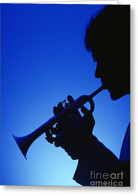 Trumpeter Silhouette Greeting Cards - Silhouette of a man playing the trumpet with a blue background  Greeting Card by Jim Corwin