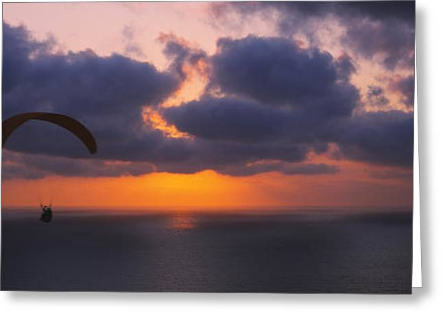 Over Hang Greeting Cards - Silhouette Of A Person Paragliding Greeting Card by Panoramic Images