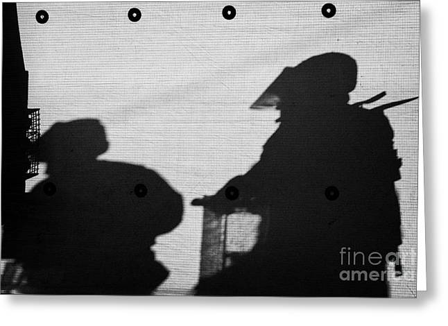Protest Greeting Cards - Silhouette of British Army soldiers on screen on crumlin road at ardoyne shops belfast 12th July Greeting Card by Joe Fox