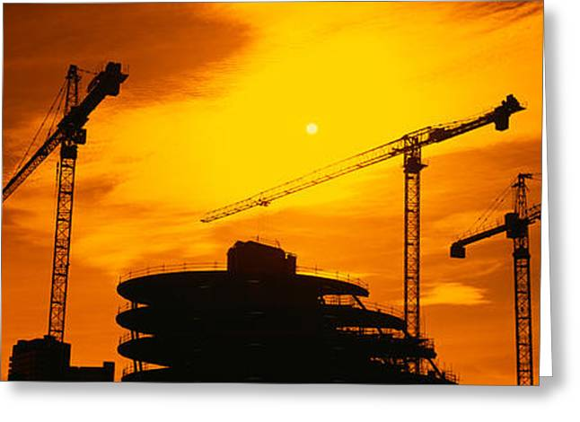 Construction Site Greeting Cards - Silhouette Of Cranes At A Construction Greeting Card by Panoramic Images