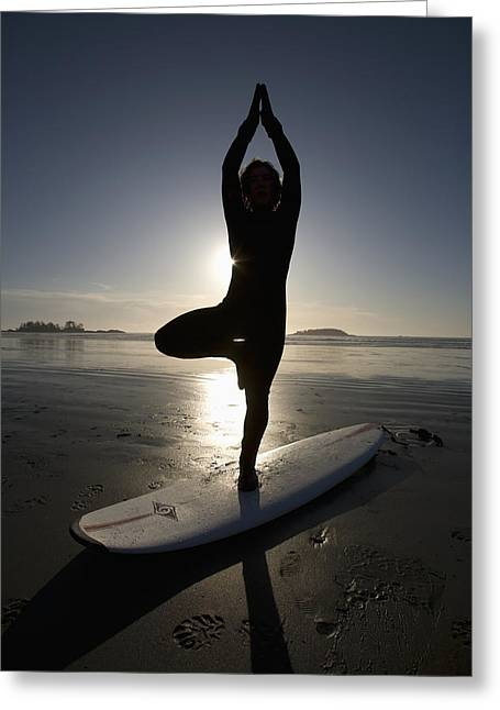 Surf Silhouette Greeting Cards - Silhouette Of Female Surfer Doing Yoga Greeting Card by Deddeda