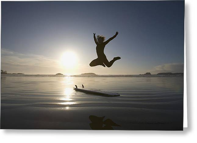Surf Silhouette Greeting Cards - Silhouette Of Female Surfer Jumping For Greeting Card by Deddeda