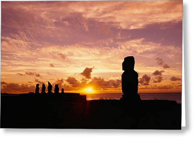 Silhouette Of Moai Statues At Dusk Greeting Card by Panoramic Images
