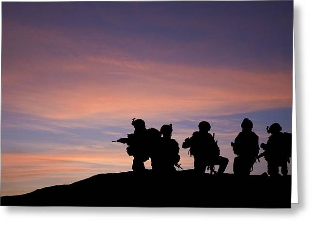 Silhouette of modern troops in Middle East silhouette against be Greeting Card by Matthew Gibson