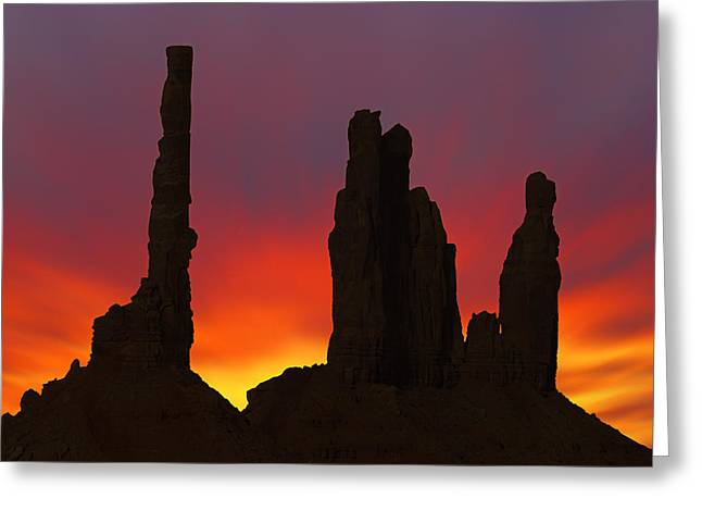 Silhouette Of Totem Pole After Sunset - Monument Valley Greeting Card by Mike McGlothlen