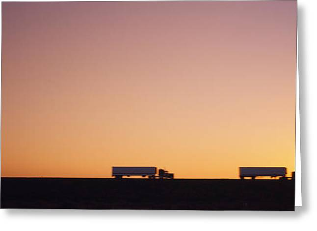 Two Objects Greeting Cards - Silhouette Of Two Trucks Moving Greeting Card by Panoramic Images