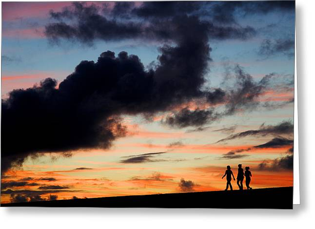 Silhouettes of three girls walking in the sunset Greeting Card by Fabrizio Troiani