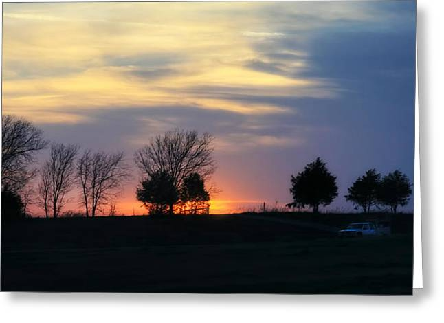 Silhouetts Of A Sunset Greeting Card by Joan Bertucci