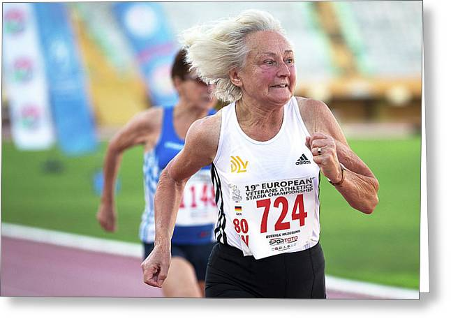 Silver-haired Female Athlete Running Greeting Card by Alex Rotas