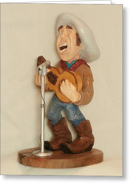 Wood Carving Sculptures Greeting Cards - Singing Cowboy Greeting Card by Russell Ellingsworth