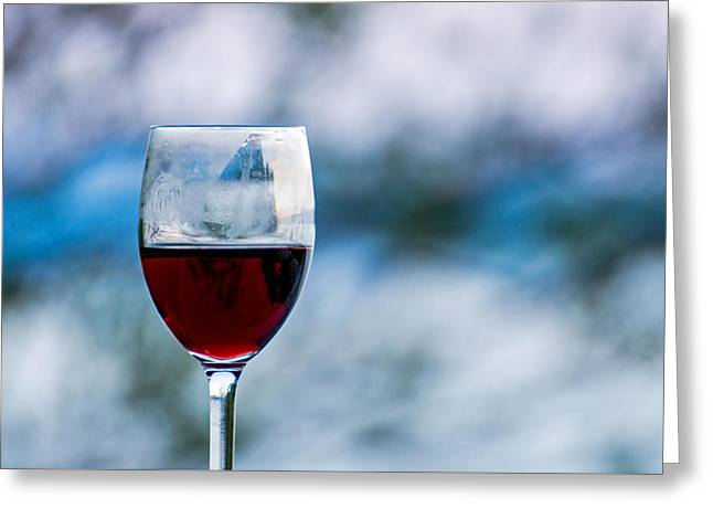 Single Glass Of Red Wine On Blue And White Background Greeting Card by Photographic Arts And Design Studio