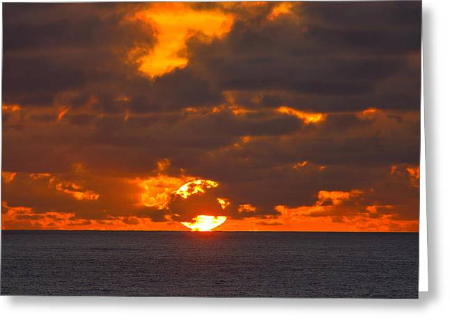 Caribbean Sunset Greeting Cards - Sinking in the Sea Greeting Card by Greg Norrell