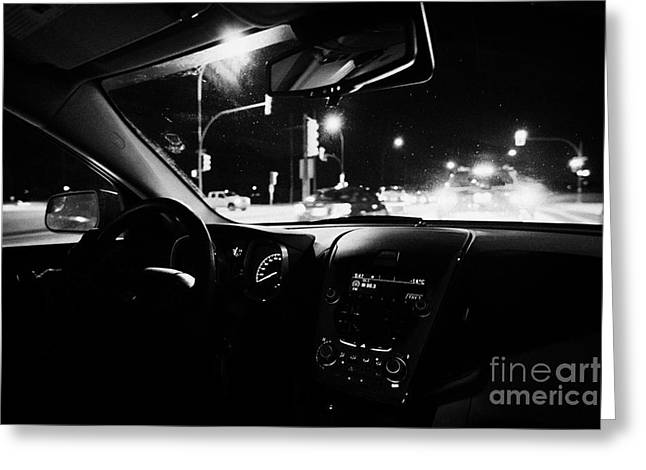 Winter Night Greeting Cards - sitting in traffic at intersection on frozen city road at night Saskatoon Saskatchewan Canada Greeting Card by Joe Fox