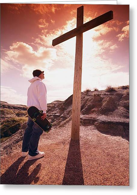 Calvary Greeting Cards - Skateboarder Standing Before A Cross Greeting Card by Don Hammond