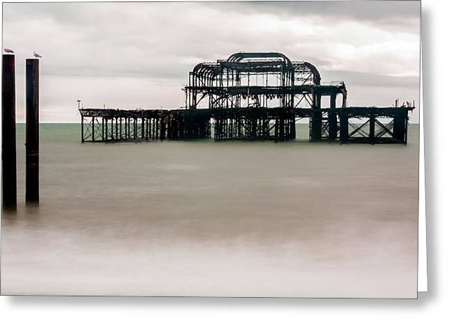 Grey Clouds Greeting Cards - Skeleton of West Pier at Brighton Greeting Card by Semmick Photo