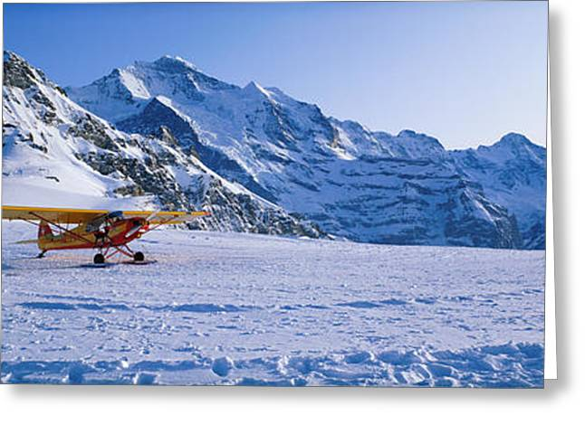 Wintry Photographs Greeting Cards - Ski Plane Mannlichen Switzerland Greeting Card by Panoramic Images